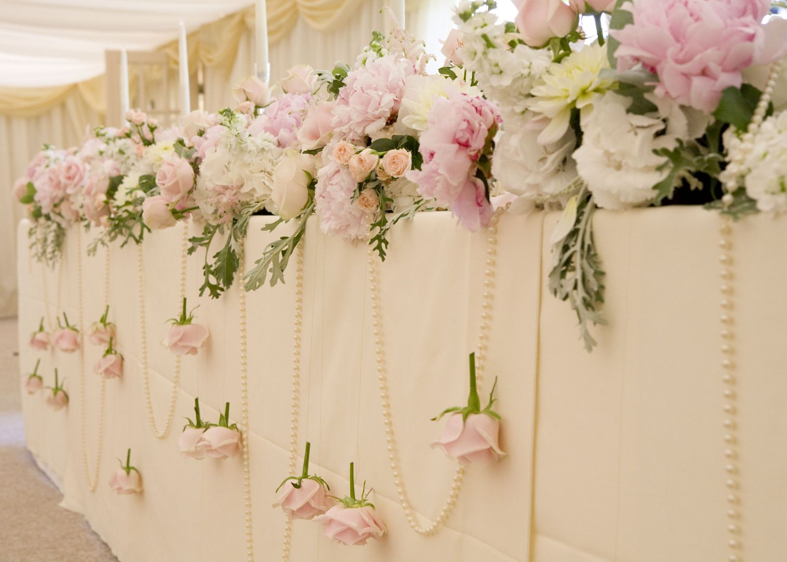... Garland Of Flowers And Pearls Along The Length Of The Top Table And  Hung Sweet Avalanche Roses On Wire To Break Up The Neutral Cream Tablecloth  With The ...