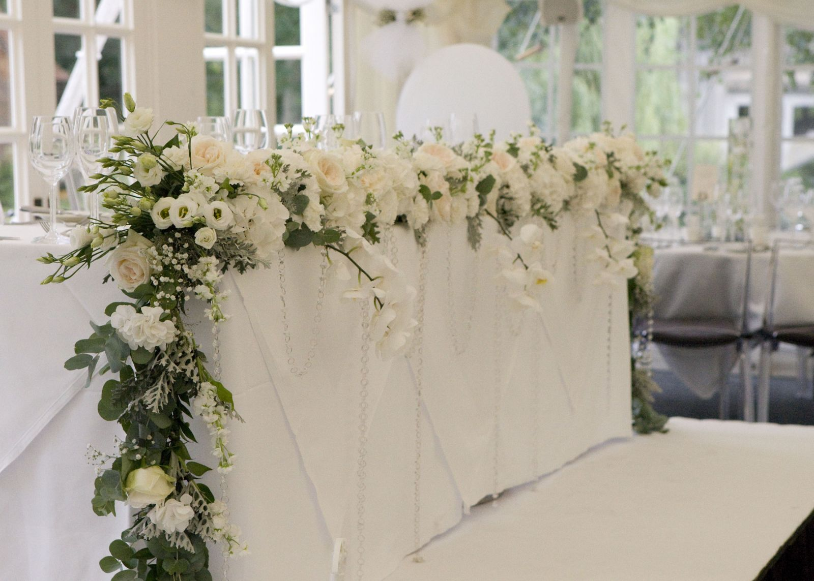 Wedding flowers how to style your top table our blog jades there are many ways of decorating the top table without relying on large displays different sized vases can look simply spectacular when used on mass mightylinksfo